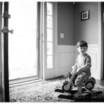 Naperville In home Child portraits, picture of little boy on rocking horse in black and white