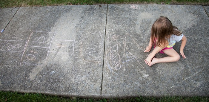 color photo for header, child on sidewalk with chalk, hopscotch, naperville child photographer
