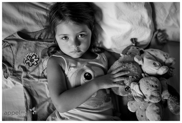 Serious Child with favorite snuggle baby dolls naperville photographer for photojournalist 233-365 2014