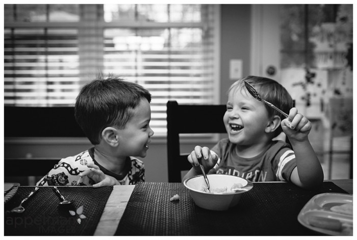 Little Boys at dinner conversation by naperville lifestyle documentary photographer kids giggling at table bw 240-365 2014