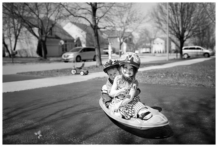 Naperville Baby and Family Photographer Lifestyle Photojournalist driveway sledding 101-365 2014