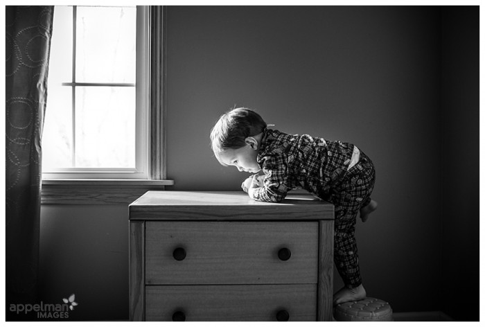 Tiny boy climbing on nightstand black and white child photography in Naperville12-365 2014