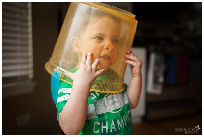 Little boy at home Naperville baby photographer smooshed nose in a bucket 121-365 2014
