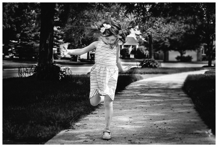 Naperville Child Portraits little girl running on a sidewalk 148-365 2014