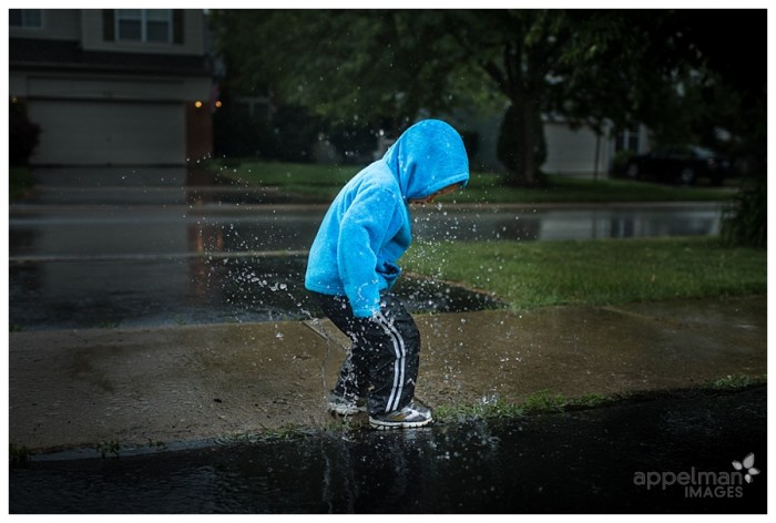 Childhood portraits big splash little puddle young boy in blue coat in the rain by custom Naperville child photographer 162-365 2014