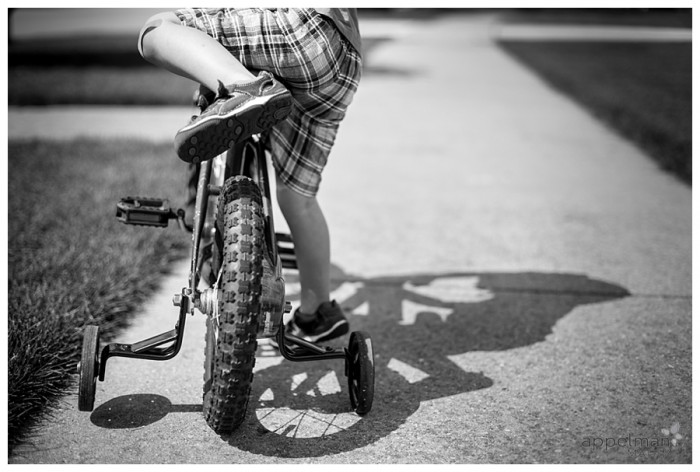Little boy climbing on a bike naperville lifestyle family photographer 176-365 2014
