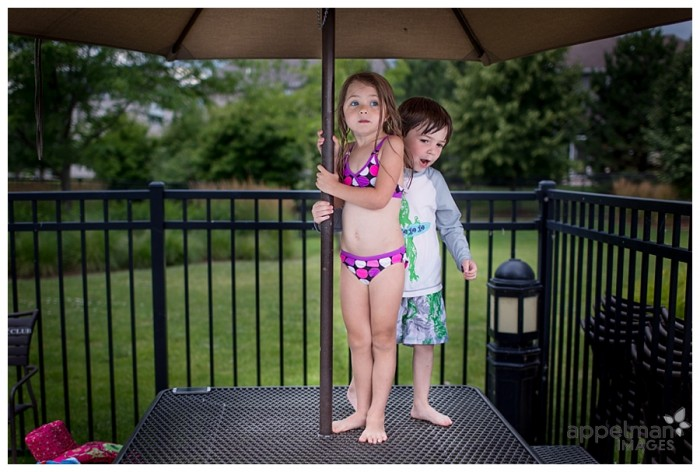 Rain delay at the pool with little boy and little girl under umbrella thunder naperville oswego family photographer 211-365 2014