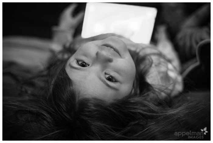 Little Girl Upside down with tablet custom lifestyle candid child photography in Naperville.jpg 42-365 2014
