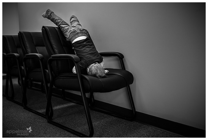 Naperville Candid Child Photographer Baby Office Entertainment Upside down on a chair 74-365 2014