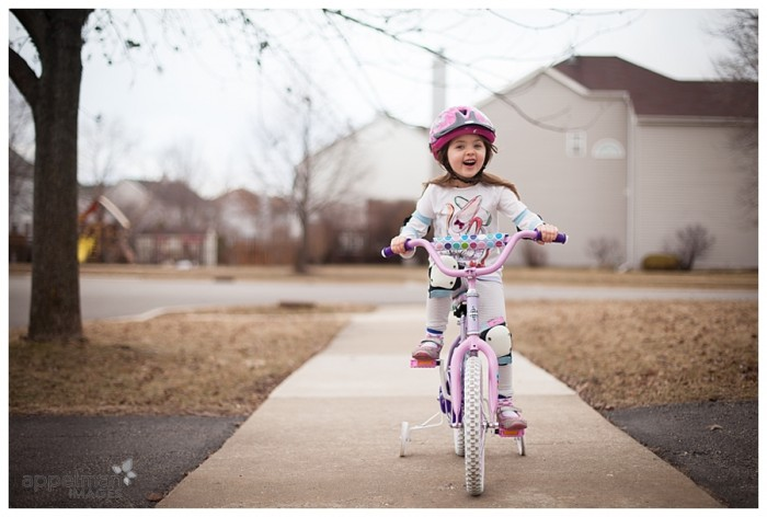Documentary Naperville Child Portrait photographer little girl on her bike for the first time this year 90-365 2014