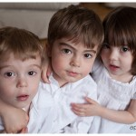 Beautiful lifestyle portrait of three children dressed in white by Naperville Child Photographer