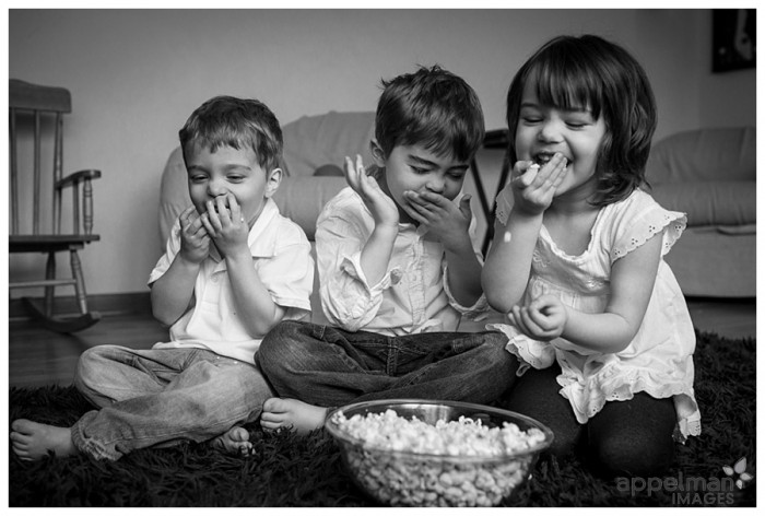 Laughter and Popcorn for three siblings by Naperville family photographer