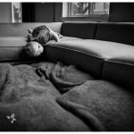baby on the couch black and white photo of little one at home playing by naperville candid photographer lifestyle session
