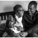family time with new baby in black and white photo by naperville lifestyle photographer