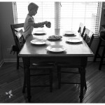 Oswego Family Lifestyle Photographer boy at the table