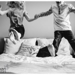 Oswego lifestyle photographer family kids jumping on the bed