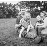 Happy family in black and white on lawn in naperville lifestyle