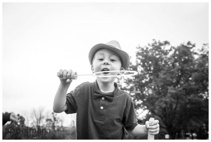bubbles and the boy in black and white in naperville family lifestyle photography