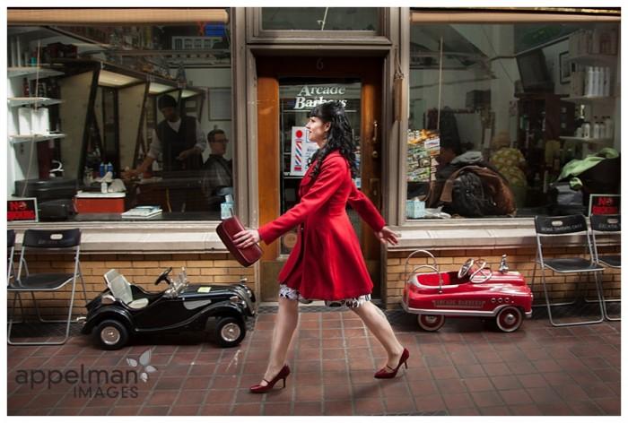AIP Red Coat walking near shops 4-2014