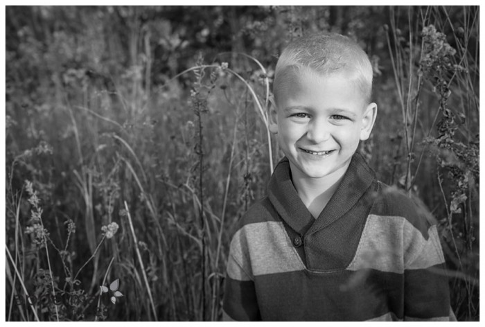 Handsome boy in outdoor mini session black and white portrait