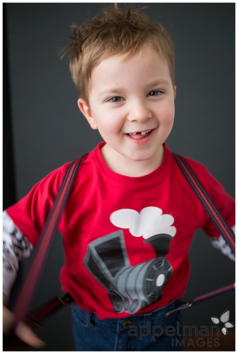 Four years old sweet boy in red train shirt naperville kids photographer