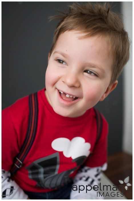 naperville studio photographer for kids little boy with suspenders