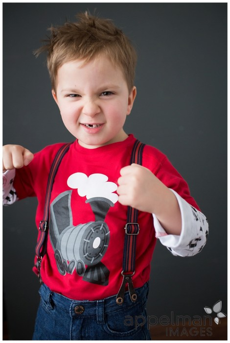 tough guy four years old in red shirt and suspenders